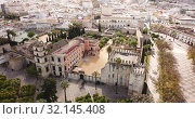 Купить «Aerial view of Catholic Cathedral and famous Alcazar of Jerez de la Frontera, Spain», видеоролик № 32145408, снято 19 апреля 2019 г. (c) Яков Филимонов / Фотобанк Лори