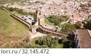 Купить «Panoramic view from drone of the castle Montemor o Novo. The Alcaides palace ruins. Evora district. Alentejo, Portugal», видеоролик № 32145472, снято 20 апреля 2019 г. (c) Яков Филимонов / Фотобанк Лори