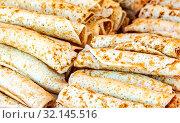 Купить «Appetizing fried pancakes on the Pancake Week», фото № 32145516, снято 17 февраля 2018 г. (c) FotograFF / Фотобанк Лори