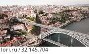 Купить «Porto city view with Douro river and Dom Luis I bridge, Portugal», видеоролик № 32145704, снято 17 июня 2019 г. (c) Яков Филимонов / Фотобанк Лори
