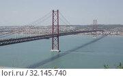 Купить «Famous Abril bridge in Lisbon, crossing the Tagus River, Portugal», видеоролик № 32145740, снято 13 мая 2019 г. (c) Яков Филимонов / Фотобанк Лори