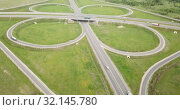 Купить «Panoramic aerial view of road junction in Russia from drone at sunny day», видеоролик № 32145780, снято 13 мая 2019 г. (c) Яков Филимонов / Фотобанк Лори