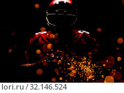 Купить «Composite image of american football player standing in rugby helmet and holding rugby ball», фото № 32146524, снято 15 сентября 2019 г. (c) Wavebreak Media / Фотобанк Лори