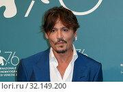Купить «Johnny Depp during 'Waiting for the Barbarians' film photocall, 76th venice Film Festival, Venice 06/09/2019.», фото № 32149200, снято 6 сентября 2019 г. (c) age Fotostock / Фотобанк Лори