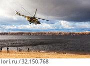 Купить «Russian military Mi-8 helicopter in action», фото № 32150768, снято 4 ноября 2015 г. (c) FotograFF / Фотобанк Лори