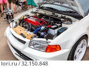 Купить «Tuned turbo car engine of Mitsubishi vehicle», фото № 32150848, снято 19 мая 2018 г. (c) FotograFF / Фотобанк Лори