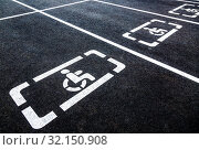 Купить «Parking places with handicapped or disabled signs», фото № 32150908, снято 29 июня 2018 г. (c) FotograFF / Фотобанк Лори