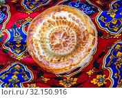 Купить «Traditional uzbek flatbread with sesame seeds», фото № 32150916, снято 21 апреля 2018 г. (c) FotograFF / Фотобанк Лори