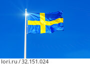 Flag of Sweden flying in the wind against the sky. Стоковое фото, фотограф FotograFF / Фотобанк Лори