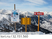 Signpost for Siviez ski lift, warning sign for avalanche danger and poster for protection of wild fauna in winter mountains (2010 год). Редакционное фото, фотограф Юлия Бабкина / Фотобанк Лори