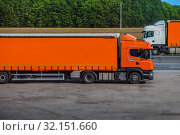 Купить «Two semi-trailers running in opposite directions», фото № 32151660, снято 29 мая 2018 г. (c) Юрий Бизгаймер / Фотобанк Лори