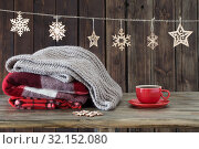 Купить «stack of plaids, cup of tea and Christmas decorations on wooden background», фото № 32152080, снято 27 ноября 2018 г. (c) Майя Крученкова / Фотобанк Лори