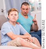 Купить «Man with his adult son are serious talking about life together», фото № 32152832, снято 25 июня 2018 г. (c) Яков Филимонов / Фотобанк Лори