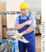 Купить «Plasterer working indoors», фото № 32153012, снято 4 мая 2018 г. (c) Яков Филимонов / Фотобанк Лори