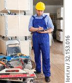 Купить «Foreman checking materials and tools», фото № 32153016, снято 4 мая 2018 г. (c) Яков Филимонов / Фотобанк Лори