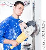 Builder handyman with angle grinder. Стоковое фото, фотограф Яков Филимонов / Фотобанк Лори
