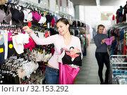 Купить «Woman choosing sexy silky bra», фото № 32153292, снято 10 декабря 2019 г. (c) Яков Филимонов / Фотобанк Лори
