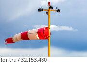 Купить «Horizontally flying windsock wind vane», фото № 32153480, снято 7 августа 2018 г. (c) FotograFF / Фотобанк Лори