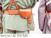Купить «Vintage leather holster on the belt», фото № 32153520, снято 6 октября 2018 г. (c) FotograFF / Фотобанк Лори