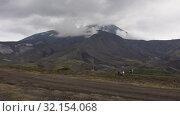 Купить «Автомобили едут по горной дороге, туристы гуляют у подножия вулкана. Time lapse», видеоролик № 32154068, снято 1 сентября 2019 г. (c) А. А. Пирагис / Фотобанк Лори
