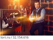 Купить «men and women co-workers having corporate entertainment», фото № 32154616, снято 4 апреля 2019 г. (c) Яков Филимонов / Фотобанк Лори