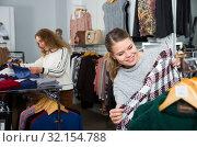 Купить «Women choosing warm coats in boutique», фото № 32154788, снято 6 декабря 2018 г. (c) Яков Филимонов / Фотобанк Лори