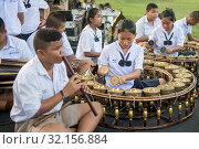 Traditional thai music at the Phimai festival at the Phimai Temple of Phimai in the Provinz Nakhon Ratchasima in Isan in Thailand. Thailand, Phimai, November, 2017. Стоковое фото, фотограф Zoonar.com/URS FLUEELER / age Fotostock / Фотобанк Лори