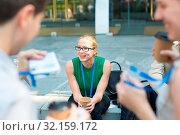 Купить «Cheerful colleagues meeting on stairs outdoor for in a quick coffee break. Coffee to go.», фото № 32159172, снято 28 марта 2020 г. (c) easy Fotostock / Фотобанк Лори