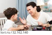 Купить «Cheerful woman telling story to son», фото № 32162140, снято 28 марта 2019 г. (c) Яков Филимонов / Фотобанк Лори