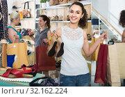 Купить «three girls holding a paper shopping bags in the boutique», фото № 32162224, снято 21 сентября 2019 г. (c) Яков Филимонов / Фотобанк Лори