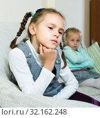 Купить «Offended girls sitting apart at home», фото № 32162248, снято 7 апреля 2020 г. (c) Яков Филимонов / Фотобанк Лори