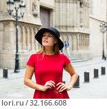 Купить «beautiful girl walks through the old European streets», фото № 32166608, снято 15 сентября 2018 г. (c) Татьяна Яцевич / Фотобанк Лори