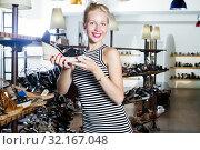 Girl looking after summer pair of shoes. Стоковое фото, фотограф Яков Филимонов / Фотобанк Лори