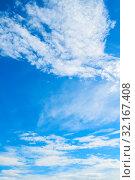 Купить «Небесный пейзаж. Синее небо. Blue sky background - picturesque colorful clouds lit by sunlight. Picturesque sky view in vivid tones», фото № 32167408, снято 3 июля 2018 г. (c) Зезелина Марина / Фотобанк Лори