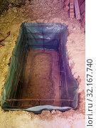 Купить «Pit with bars framework prepared for concrete», фото № 32167740, снято 10 июня 2018 г. (c) Сергей Новиков / Фотобанк Лори