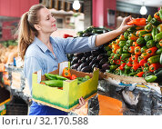 Купить «Woman with vegetarian box in market», фото № 32170588, снято 29 апреля 2018 г. (c) Яков Филимонов / Фотобанк Лори