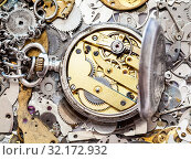 Купить «Watchmaker workshop - open old silver pocket watch with brass clockwork on heap of clock spare parts», фото № 32172932, снято 29 января 2020 г. (c) easy Fotostock / Фотобанк Лори
