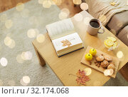 Купить «book, lemon, tea and cookies on table at home», фото № 32174068, снято 15 ноября 2017 г. (c) Syda Productions / Фотобанк Лори