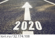 Купить «white road marking in form of 2020 year and arrow», фото № 32174108, снято 10 февраля 2018 г. (c) Syda Productions / Фотобанк Лори