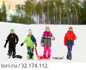 Купить «happy little kids with sleds in winter», фото № 32174112, снято 10 февраля 2018 г. (c) Syda Productions / Фотобанк Лори