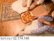 Купить «happy female friends eating pizza at home», фото № 32174140, снято 21 января 2018 г. (c) Syda Productions / Фотобанк Лори