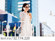 Купить «smiling asian woman calling on smartphone in city», фото № 32174220, снято 13 июля 2019 г. (c) Syda Productions / Фотобанк Лори