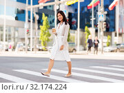 Купить «asian woman with takeaway coffee cup in city», фото № 32174224, снято 13 июля 2019 г. (c) Syda Productions / Фотобанк Лори