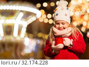 Купить «happy girl with cup of tea at christmas market», фото № 32174228, снято 4 января 2019 г. (c) Syda Productions / Фотобанк Лори