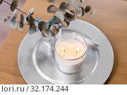 Купить «burning white candles on table at cozy home», фото № 32174244, снято 12 апреля 2019 г. (c) Syda Productions / Фотобанк Лори