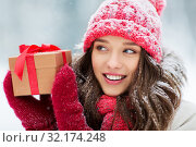Купить «happy young woman with christmas gift in winter», фото № 32174248, снято 29 января 2019 г. (c) Syda Productions / Фотобанк Лори