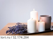 Купить «candles, tea in mug and lavender flowers on table», фото № 32174284, снято 12 апреля 2019 г. (c) Syda Productions / Фотобанк Лори