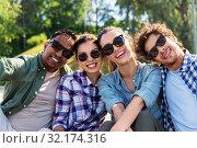 Купить «happy friends taking selfie at summer park», фото № 32174316, снято 15 июня 2019 г. (c) Syda Productions / Фотобанк Лори