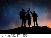 Купить «travelers making high five over starry night sky», фото № 32174556, снято 31 августа 2014 г. (c) Syda Productions / Фотобанк Лори