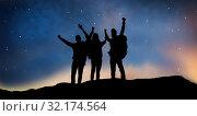 Купить «travelers celebrating success over night sky», фото № 32174564, снято 31 августа 2014 г. (c) Syda Productions / Фотобанк Лори